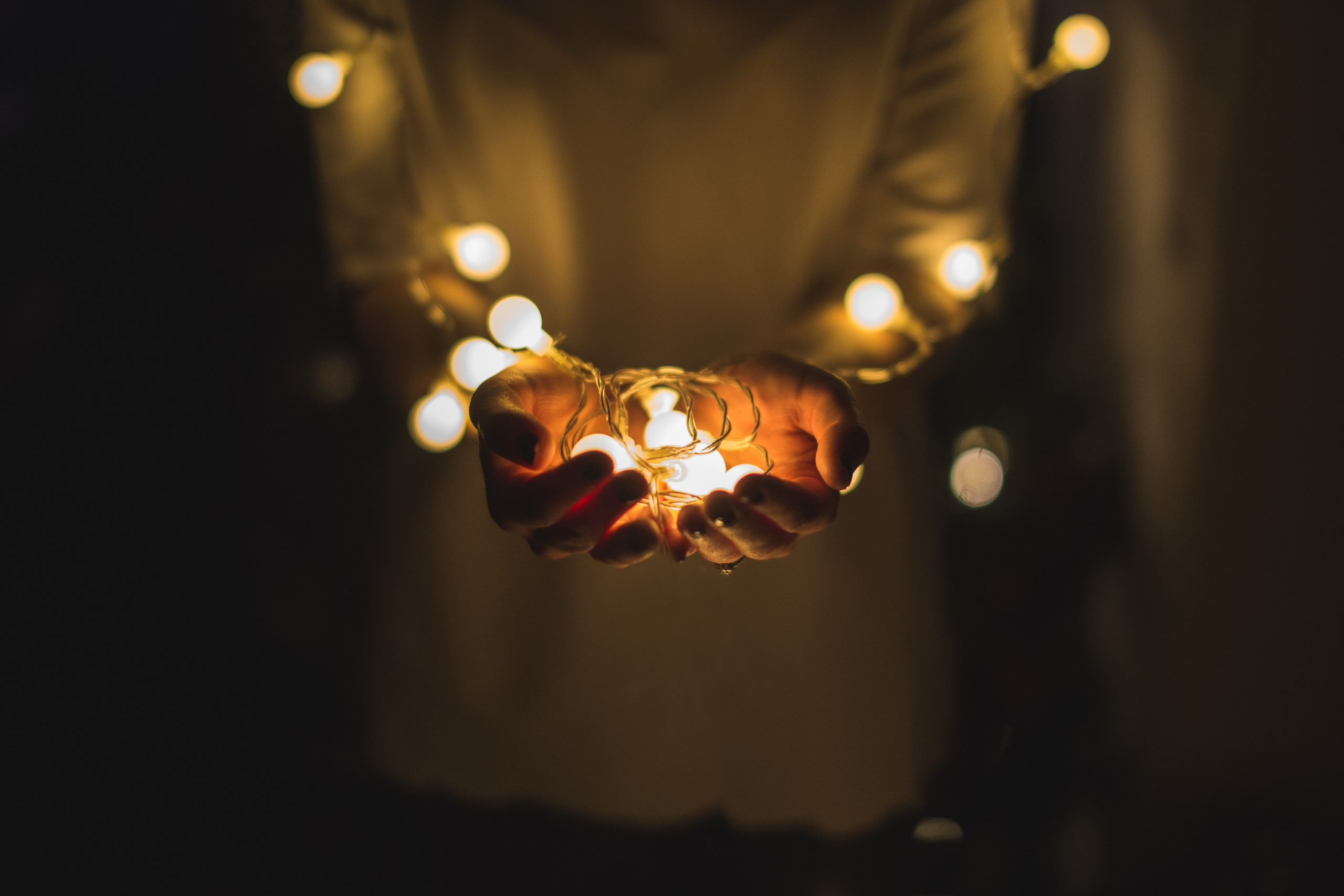 light in hands with fairy lights