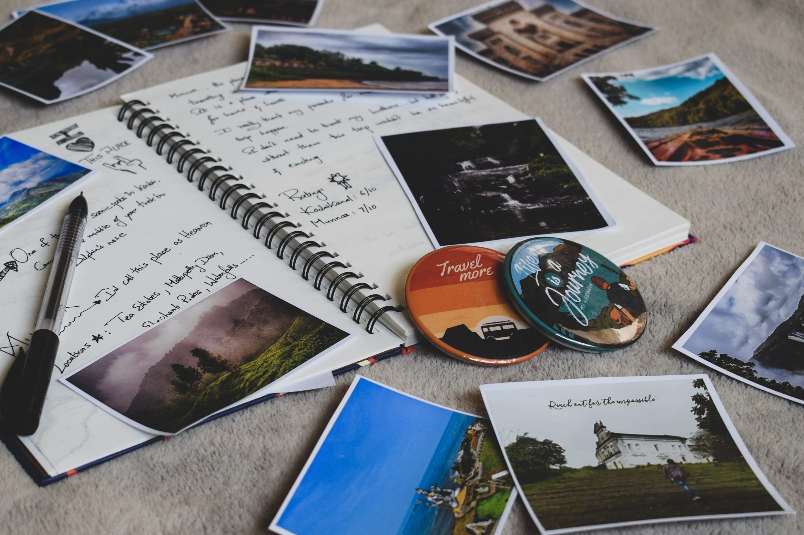 photos on table with notebook