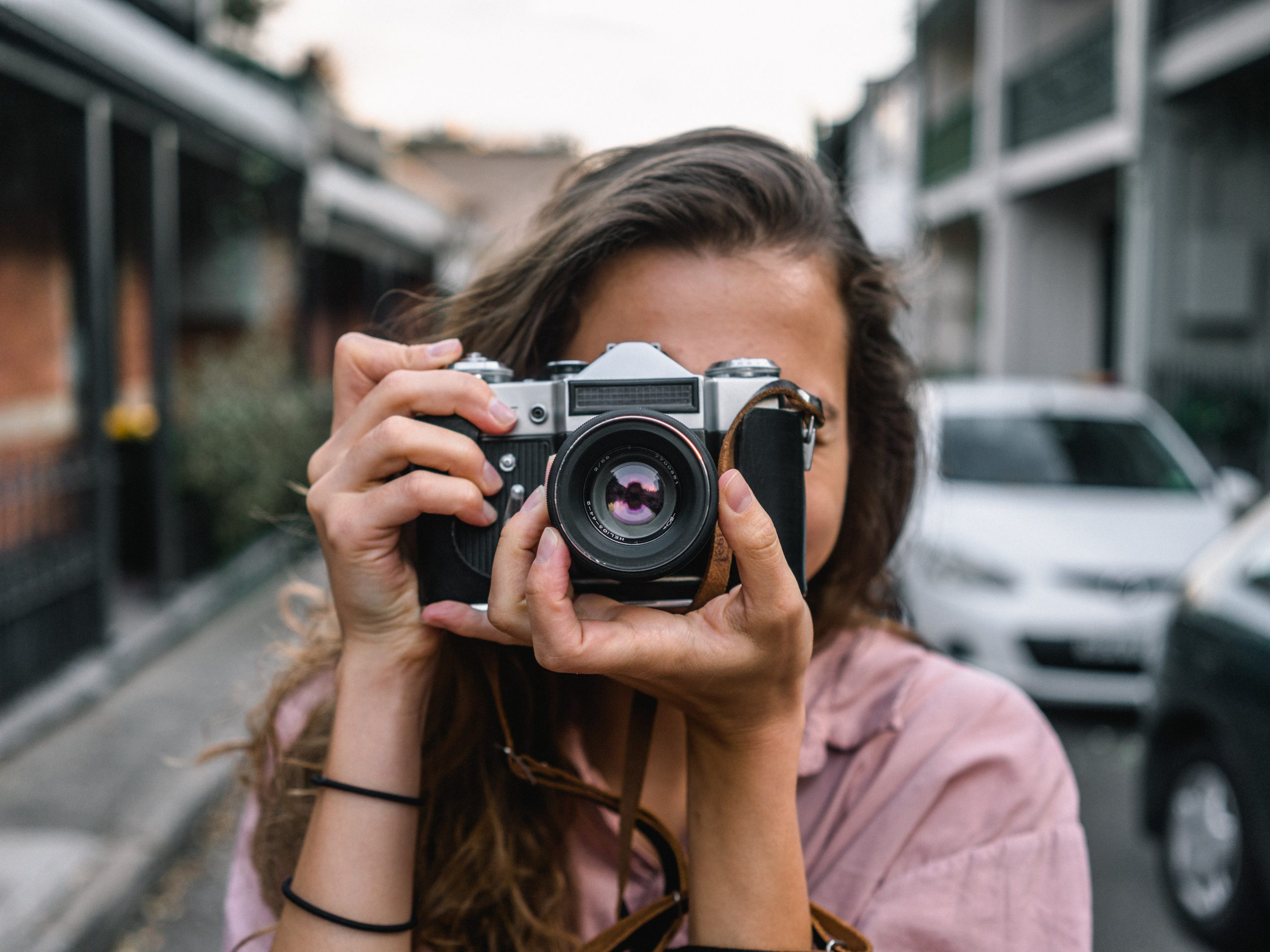 photographer with street background